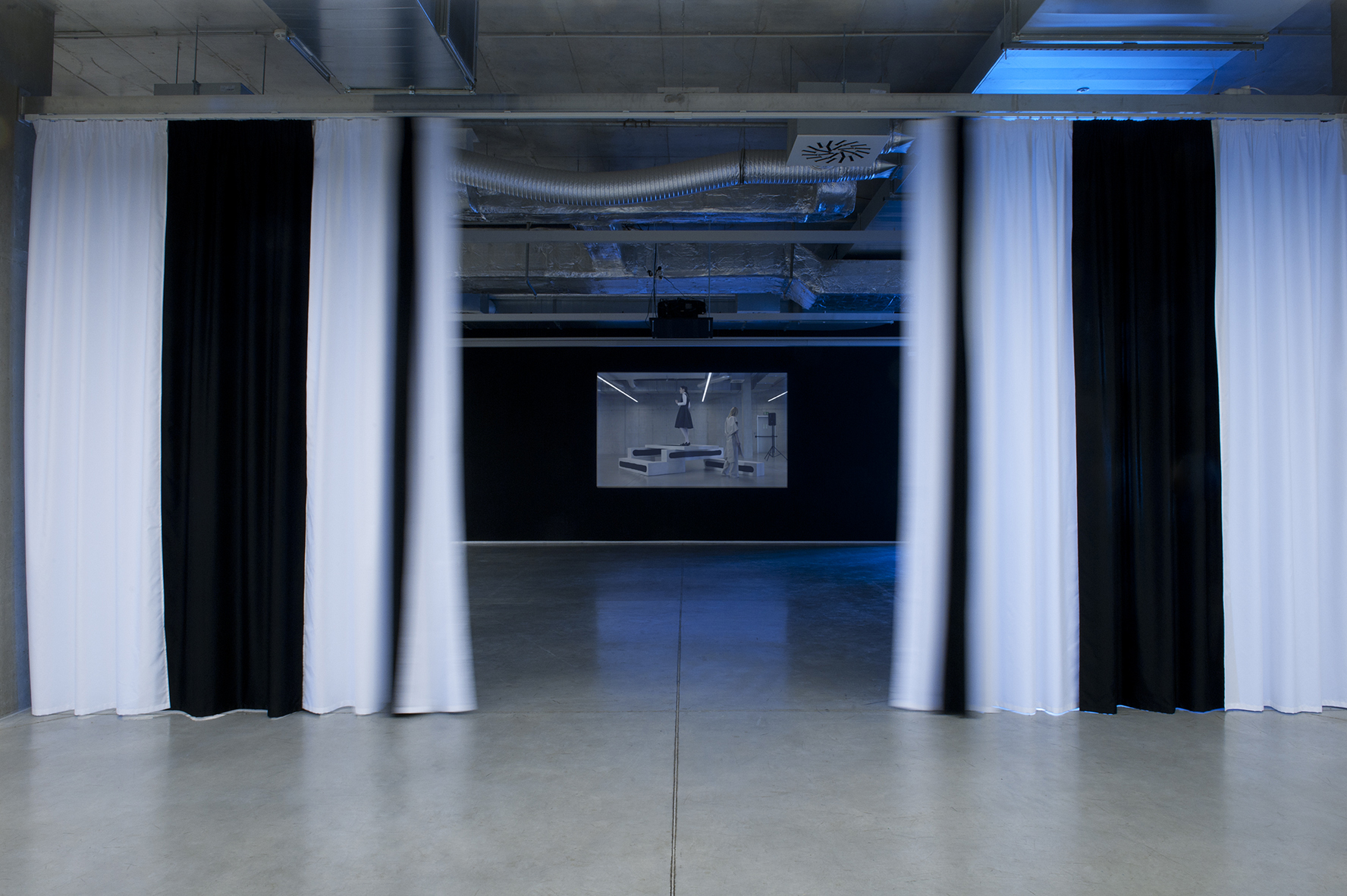The Exhibition, Rafani groupe, The Curtain, installation, 2010 and Nicholas Riis, Nora Turato, Jana Plodková, Exhibition Guide, HD video, 2015